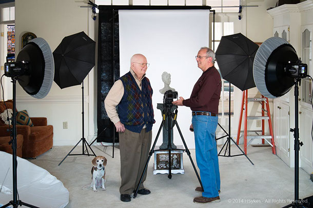 Instructor Howard Sykes teachs student how to use studio lighting.